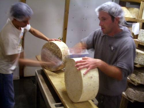 Brushing wheels of Cabot Clothbound Cheddar