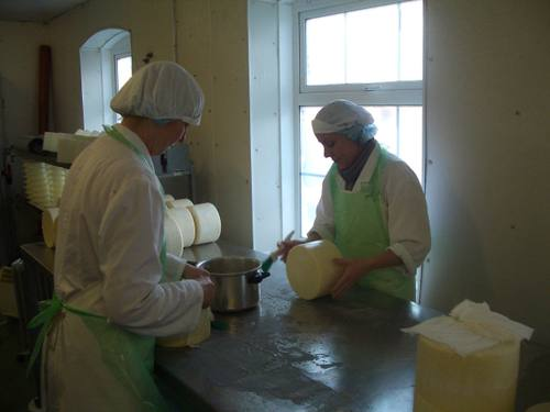Dairymaids brushing the cheese with some lovely lard